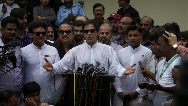 Imran Khan speaks to the media after casting his vote in the Pakistan general election.