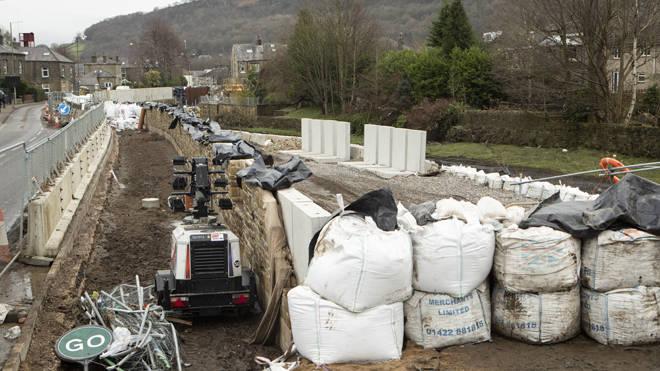 Flood defences in Mytholmroyd in the Upper Calder Valley in West Yorkshire, ahead of Storm Dennis