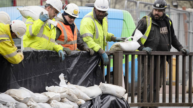 Workers construct flood defences in Mytholmroyd in the Upper Calder Valley in West Yorkshire