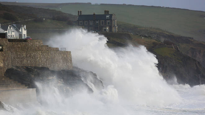 Waves crash into the sea wall at Porthleven in Cornwall during Storm Ciara - worse weather is expected this weekend