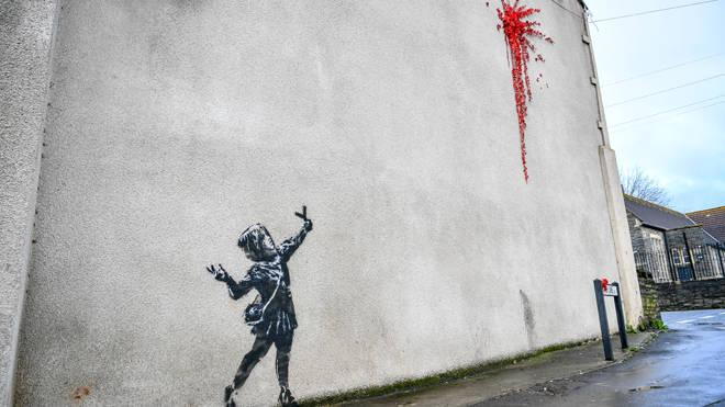 The artwork before a graffiti vandal got to it