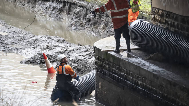 Flood defences are prepared in Mytholmroyd, in the Upper Calder Valley in West Yorkshire,