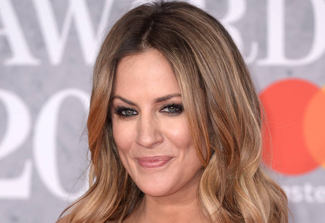 Caroline Flack's management have slammed the CPS for pressing ahead with assault charges