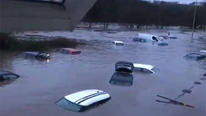 Cars under water in the village of Taff Well north of Cardiff