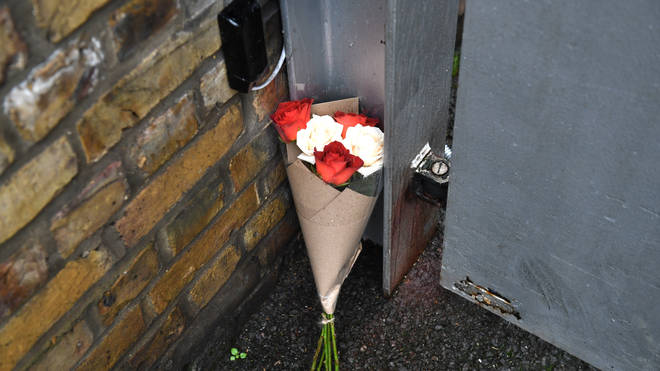 Floral tributes were laid outside Ms Flack's home