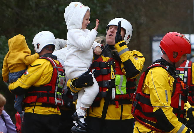Rescuers kept spirits high as they ensured residents were safe