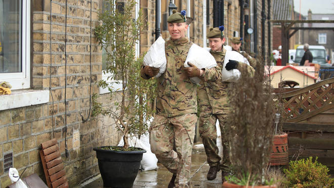 Soldiers deliver sandbags to homes in the Upper Calder Valley in West Yorkshire