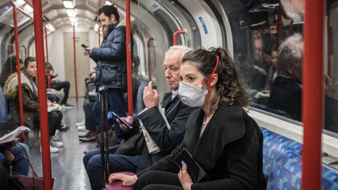 Tube passengers in London use masks for protection