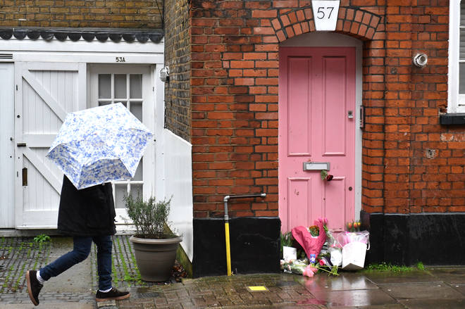 Floral tributes were left outside Caroline Flack's house