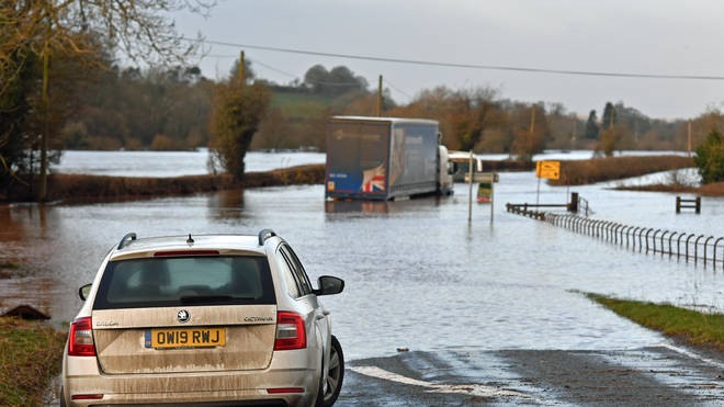 Motorists faced treacherous driving conditions with roads flooded around UK