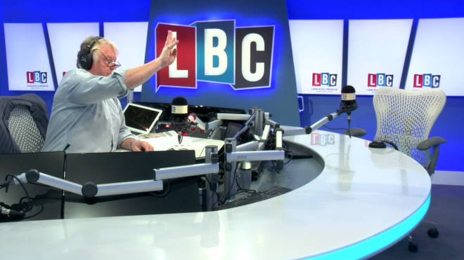 Nick Ferrari indicates to his producer that he wants to bring the next caller into the conversation