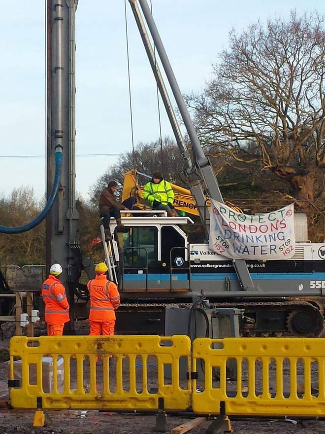 Protesters climb on the crane