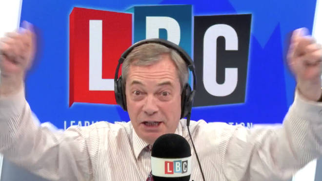 Nigel Farage waves hand in the studio