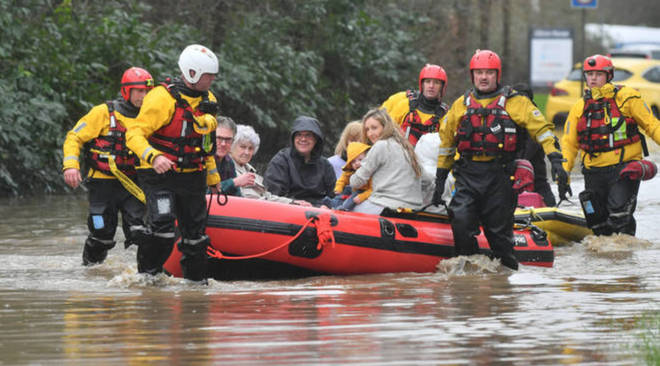 Members of the public are rescued after flooding in Nantgarw, Wales as Storm Dennis hit the UK.