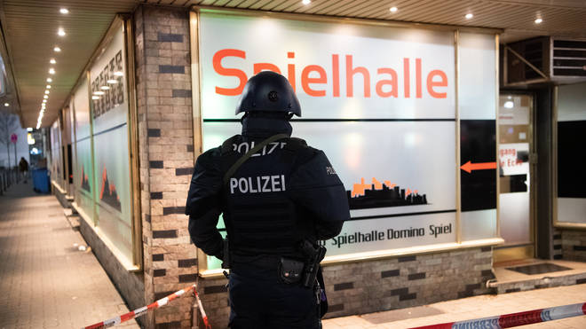 An armed German police officer at the scene of one of the attacks