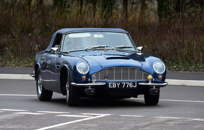Prince Charles arrived in his wine-powered Aston Martin