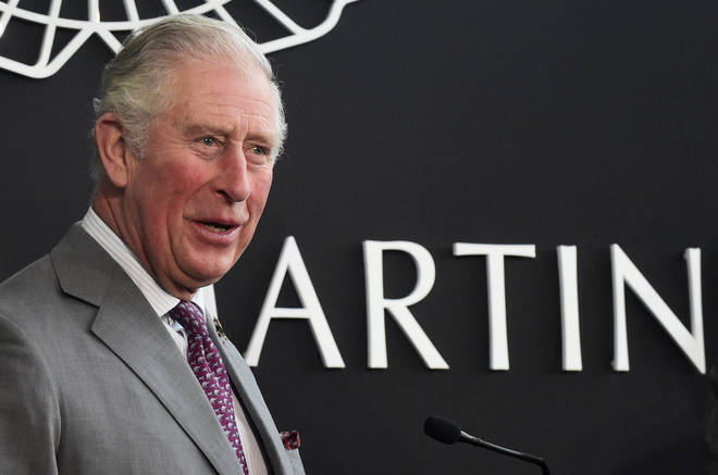 The prince of wales is visiting the Aston Martin plant as part of his tour of flood-hit areas