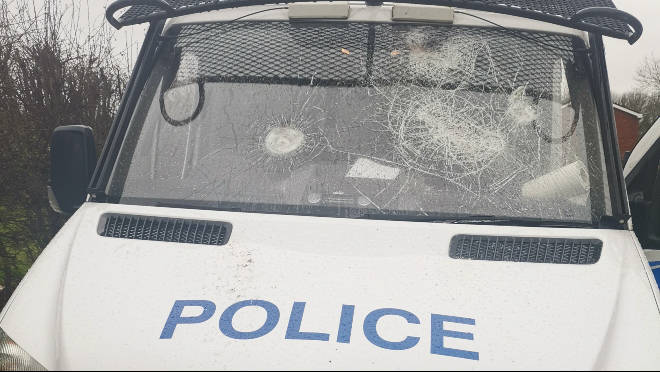 Three police vans were damaged by vandals in Salford