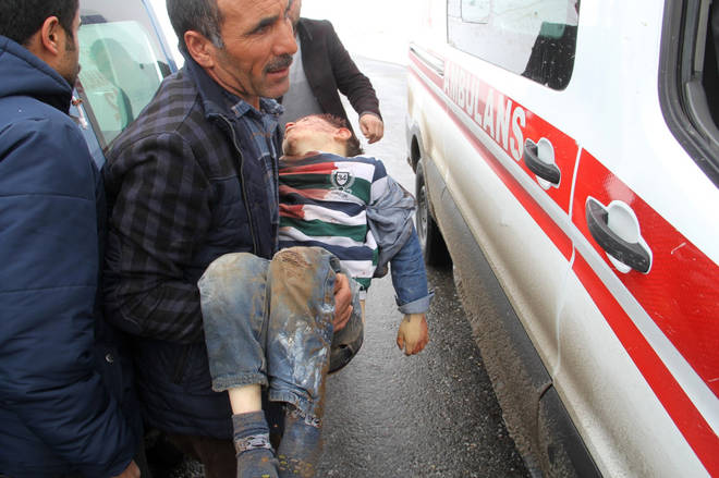 One man was spotted carrying an injured child to an ambulance following the quake