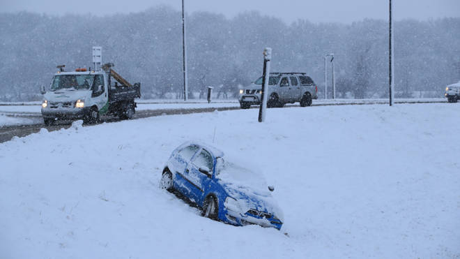 A car that has come off the road in snow in Bedale, North Yorkshire