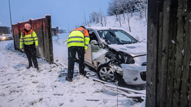 A traffic officer talks to the driver of a crashed car near Leeming Bar in North Yorkshire