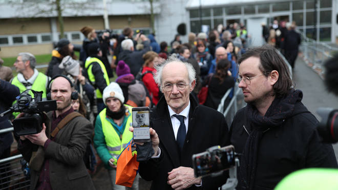 John Shipton (centre), the father of Julian Assange, at court