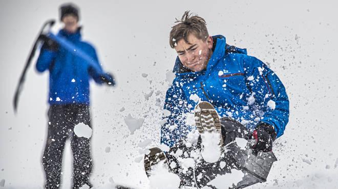 A boy enjoys the snowy weather on a sledge near Leyburn in the Yorkshire Dales