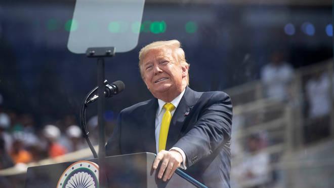Donald Trump addresses the crowd at the Sandar Patel Stadium