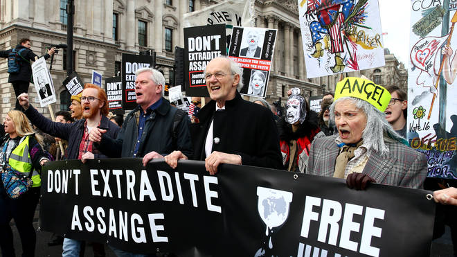 Protestors against the UK government's intention to extradite WikiLeaks founder Julian Assange to the United States