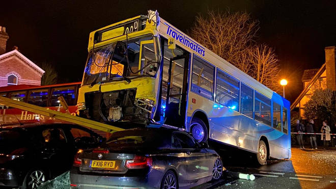 The bus mounted the parked cars outside Lingfield station on Monday evening