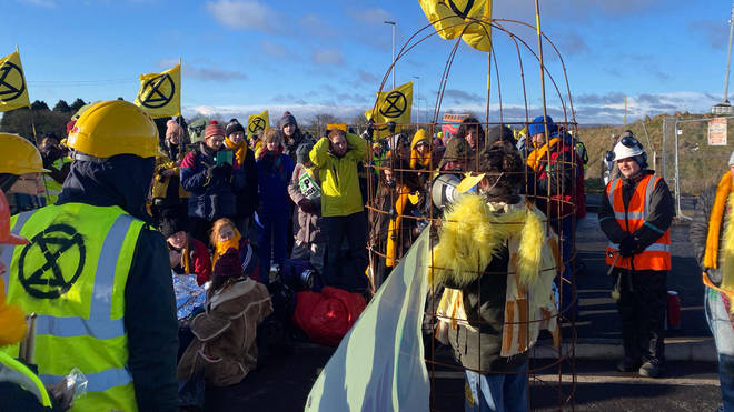 XR protesters block the mine's entrance