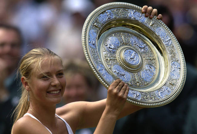 Sharapova lifting the Wimbledon trophy in 2004 after beating Serena Williams