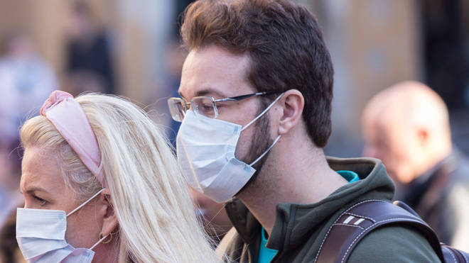 A bearded man in Italy wears a facemask