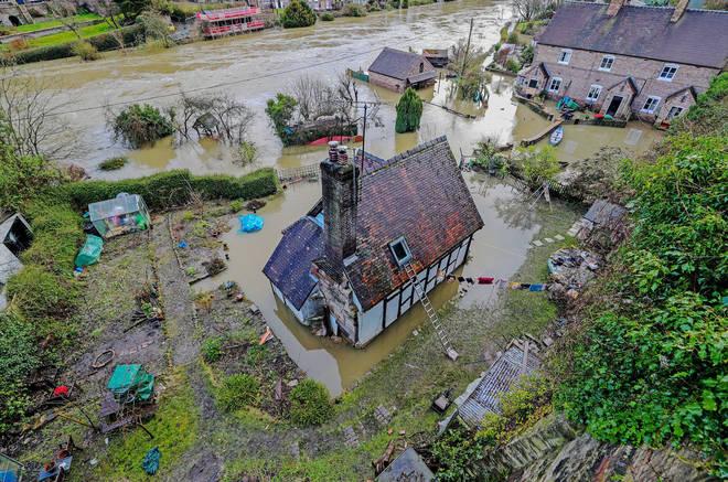 Some residents in Ironbridge, Shropshire, dug in despite the rising tide