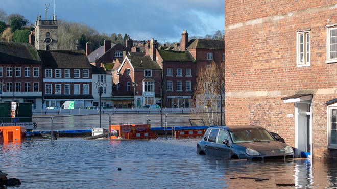 A Porsche sits in flood water Flood defences in Bewdley, Worcestershire