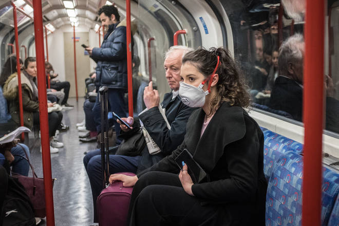 A woman wearing a facemask to ride the tube
