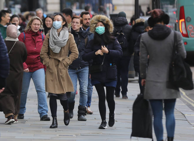 People wearing face masks as they walk around London