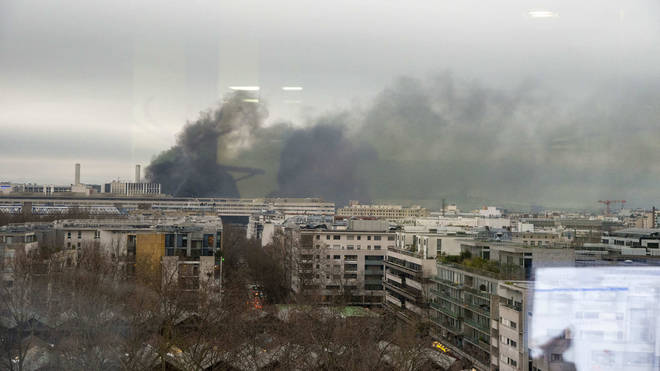 Smoke can be seen rising from the blaze over the city