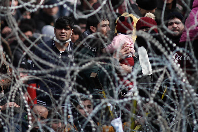 Thousands of people have gathered at Greece's land border with Turkey