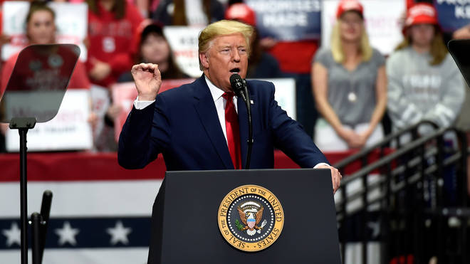 President Donald Trump speaks during a campaign rally in Charlotte on Monday
