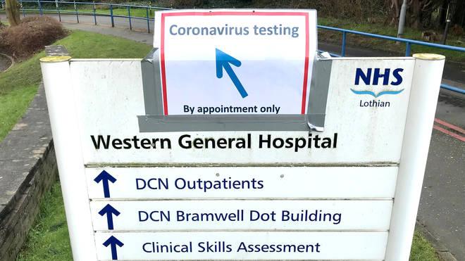 Signs for coronavirus testing at the Western General Hospital, Edinburgh
