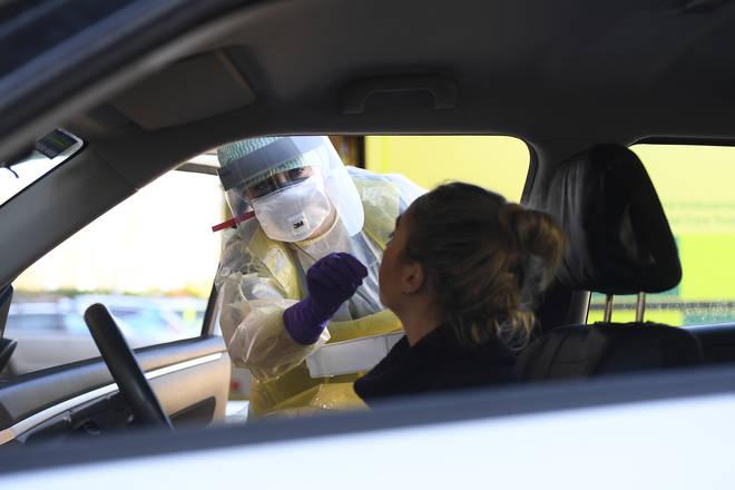 A nurse taking swabs at a coronavirus drive through test centre