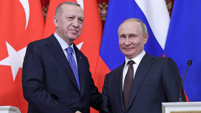 Mr Putin (L) and Mr Erdoğan (R) say they have agreed to a Syrian ceasefire
