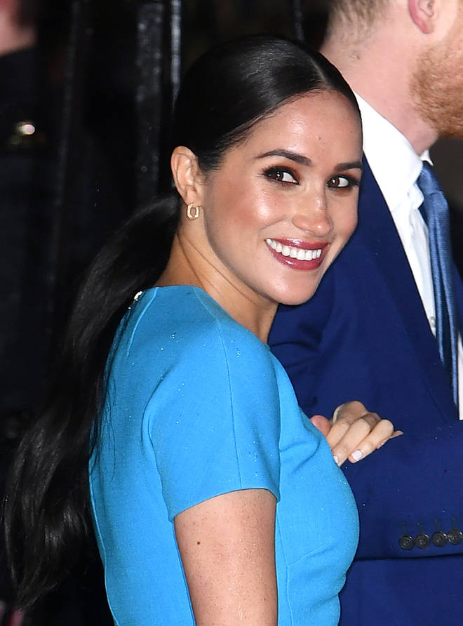 Meghan donned a blue Victoria Beckham dress for the event