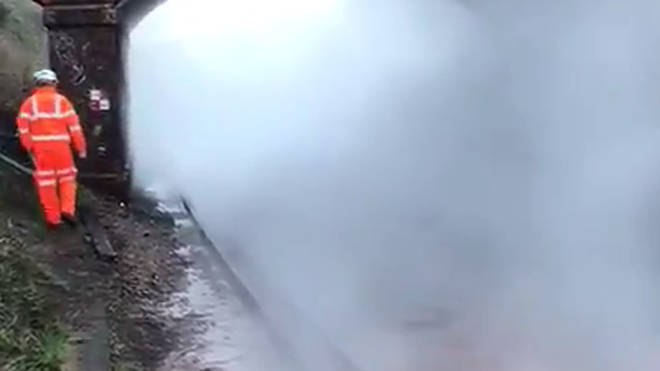 Steam is rising from the track bed