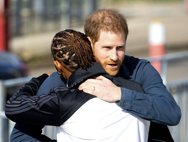 Harry and Lewis Hamilton embraced when they saw each other.