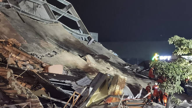 At least 30 people were pulled from the rubble after the Xinjia hotel in Quanzhou collapsed