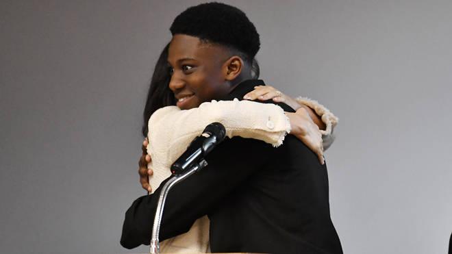 Aker Okoye, 16, hugs Meghan Markle at the school in east London