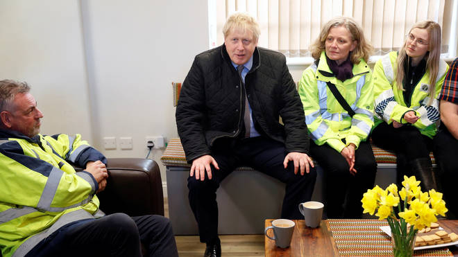 Britain's Prime Minister Boris Johnson meets with emergency services' members as he visits Bewdley