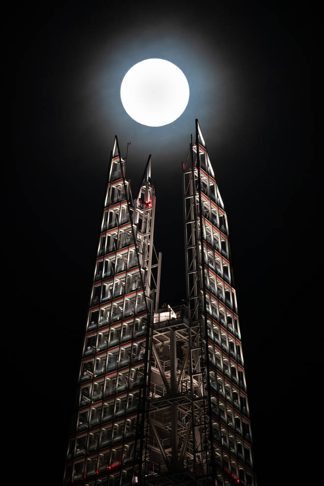 A super moon rises above the Shard